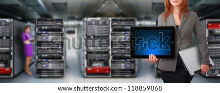 Programmer team in server room for service - stock photo