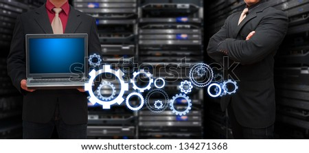 Programmer team with gear for success - stock photo