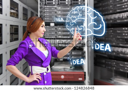 Programmer touch on idea in data center room - stock photo