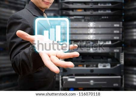Programmer with Graph icon in server room - stock photo