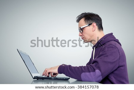 Programmer with laptop - stock photo