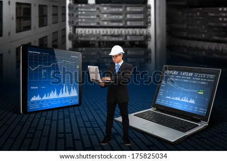 Programmer working with digital laptop - stock photo