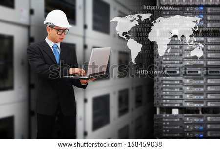 Programmers in data center room and world map  - stock photo