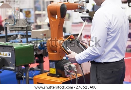 Programming and operating the robotic arm - stock photo