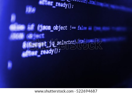 Programming code on computer screen. Server logs analysis. Programmer developer screen. Website codes on computer monitor. Source code close-up. Notebook closeup photo.
