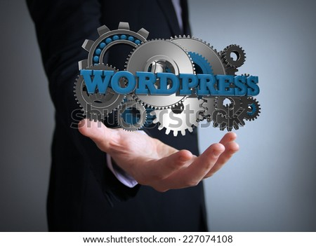 programming concept: text wordpress with gears over businessman hand - stock photo