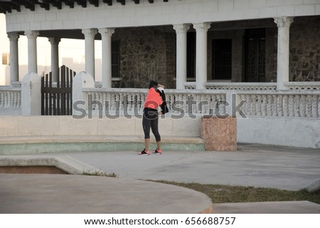 PROGRESO, MEXICO - JANUARY 27,2017: Unidentified young woman stretching  in Progreso Mexico January 27 2017