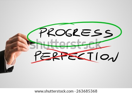 Progress - Perfection concept with a businessman crossing through the handwritten word Perfection in red while ringing Progress in green conceptual of sacrificing perfection to develop and progress. - stock photo