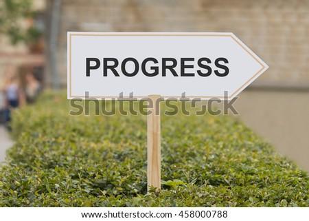 progress signpost - stock photo
