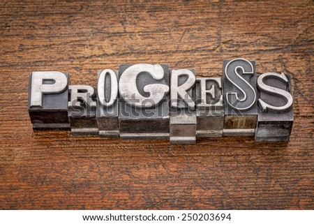 progress word in mixed vintage metal type printing blocks over grunge wood - stock photo