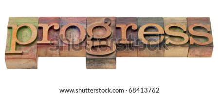 progress - word in vintage wooden letterpress printing blocks, stained by color inks, isolated on white - stock photo