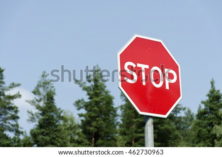"prohibiting sign on forest and sky background "" Stop "" sign"