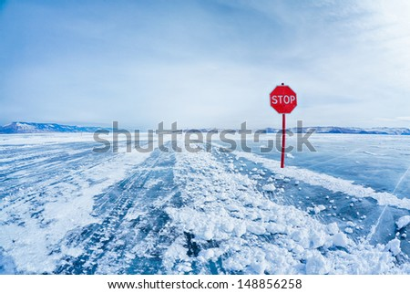 Prohibitive Stop traffic sign on Baikal ice crossing to Olkhon island - stock photo