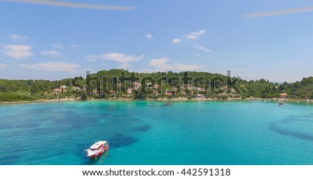 Proizd beach near dalmatian Island of Korcula ,Croatia.Beautiful peaceful island with crystal clear sea full of wildlife.Active summer diving location. Aerial view on  beach and stationary boat .  - stock photo