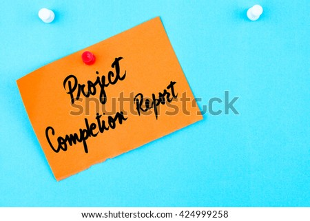 Project Completion Report written on orange paper note pinned on cork board with white thumbtack, copy space available