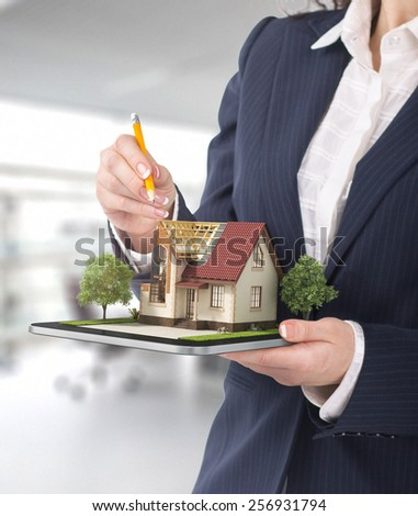 Project concept. Demonstration of an architectural project. Man draws a house project on the tablet. - stock photo