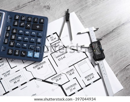 Project drawing and digital ruler - stock photo