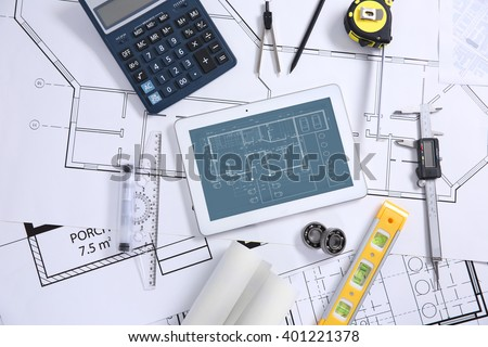 Project drawings and tablet, top view - stock photo