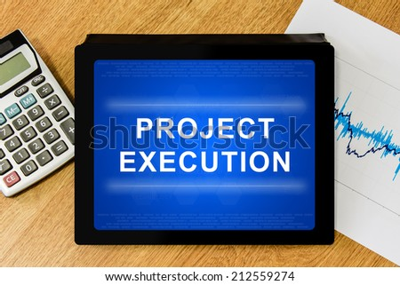 project execution word on digital tablet with calculator and financial graph - stock photo