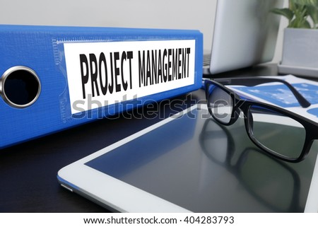 PROJECT MANAGEMENT Office folder on Desktop on table with Office Supplies. ipad