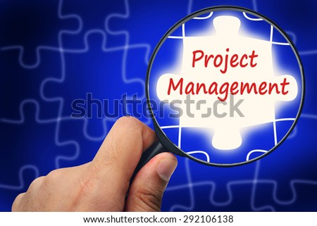 Project management word. Magnifier and puzzles. - stock photo