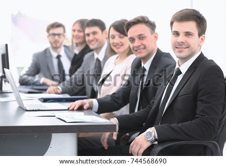 project Manager and professional business team sitting at Desk