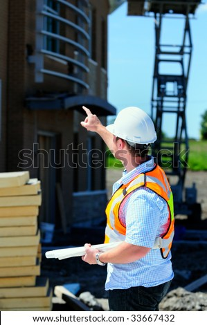 Project Manager Checking Out A New Building Construction - stock photo