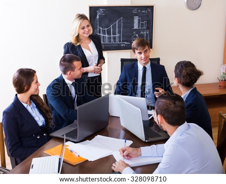 Project manager congratulating work superintendent with successful results in an office  - stock photo