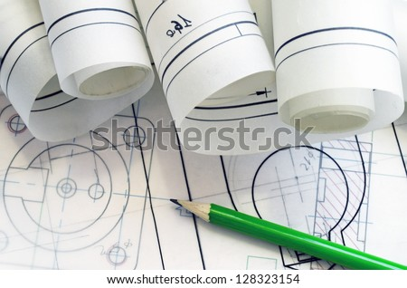 project mechanical engineer with pencil and graphic - stock photo