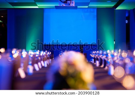 Projector monitor in blue & green light - stock photo