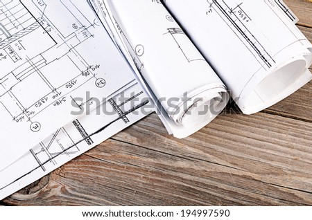 Projects of houses on the wooden background
