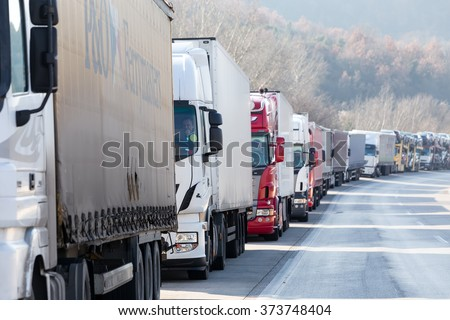 Promachonas, Greece - February 7 2016 :International transport trucks are blocked  from the border crossing of Promachonas between Greece and Bulgaria, as farmers set up a blockade at customs offices. - stock photo