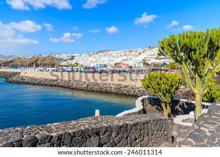 Promenade along ocean coast in Puerto del Carmen holiday town, Lanzarote, Canary Islands, Spain - stock photo