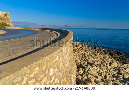 Promenade along the coast and below Fortezza fortress at morning, city of Rethymno, Crete, Greece - stock photo