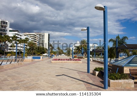 Promenade and apartment buildings in Marbella resort city on Costa del Sol in Spain, Malaga province.