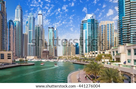 Promenade and canal in Dubai Marina with luxury skyscrapers around,United Arab Emirates