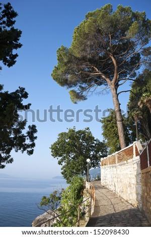 Promenade by the Mediterranean Sea in resort town of Opatija in Croatia - stock photo