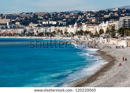 Promenade des Anglais and Beautiful Beach in Nice, French Riviera, France - stock photo