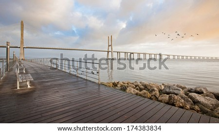 Promenade in front of of Vasco da Gama Bridge. Lisbon, Portugal. It is the longest bridge in Europe (including viaducts), with a total length of 17.2 km (10.7 mi). - stock photo