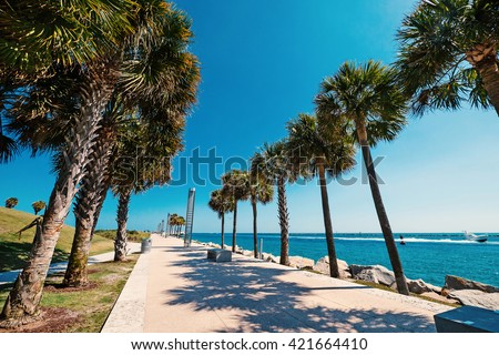 Promenade in South Pointe Park in a sunny day. Miami Beach, Florida.