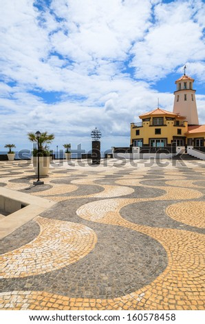Promenade square sea view lighthouse building, Madeira island, Portugal - stock photo