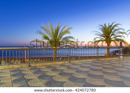 Promenade to the beach at sunset in Taurito on Gran Canaria island, Spain