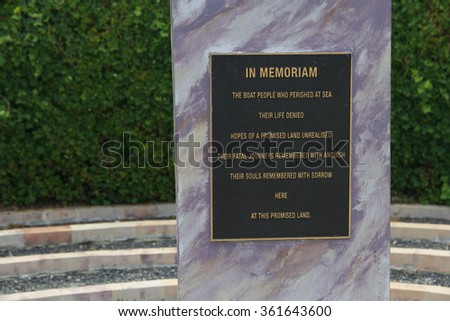 PROMISE LAND, AUSTRALIA - NOVEMBER 14: Plaque dedicated to dead at sea refugee boat people as part of Tazmazia maze park tourist attraction