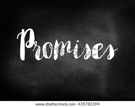 Promises written on a chalkboard - stock photo
