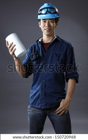 Promising young Asian engineers - stock photo