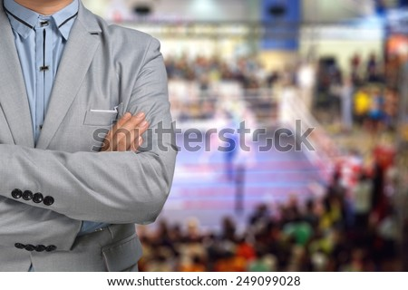 Promoter or Manager of Boxing in suit with ring on the Background - stock photo