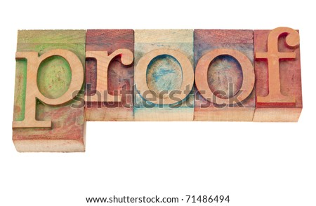 proof word in vintage wooden letterpress printing blocks, stained by color inks, isolated on white
