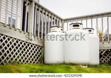 Propane Cylinders in the backyard of a House