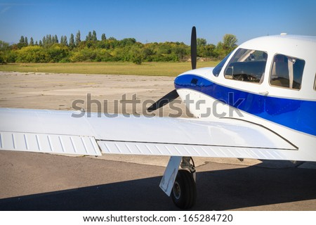 Propeller air plane on runway waiting for take off - stock photo