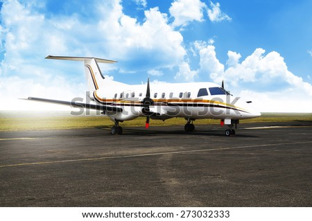 Propeller airplane parking at the airport. With blue sky background